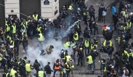 «Κίτρινα γιλέκα»: Πεδίο μάχης το Παρίσι - Δακρυγόνα και μπαράζ συλλήψεων - 126 τραυματίες (βίντεο)
